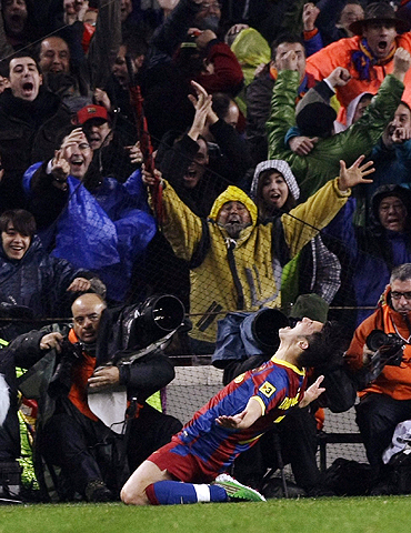 Barcelona's David Villa celebrates after scoring his second goal against Real Madrid at Nou Camp on Monday