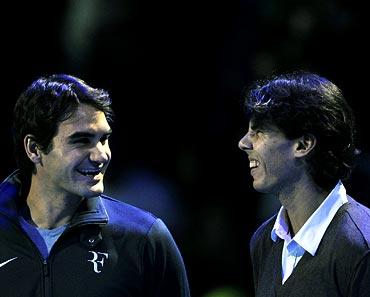 Roger Federer (left) with Rafael Nadal
