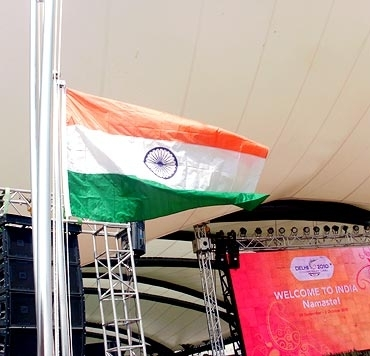 Indian tri-colour being hoitsted at Games Village
