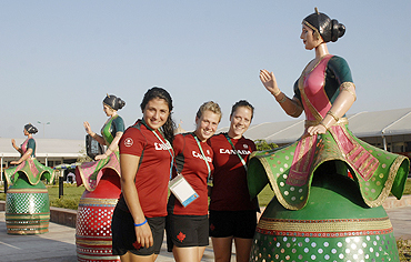 Canada's field hockey players Anna Kozniuk, Diana Roemer and Abigail Raye at the Village