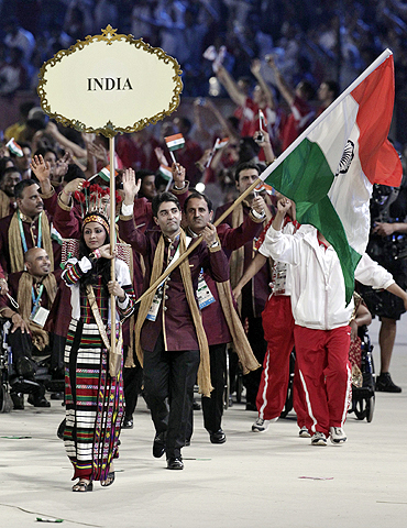 India's flag-bearer Abhinav Bindra leads the Indian contingent at the opening ceremony