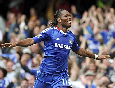 Didier Drogba celebrates after scoring against Arsenal