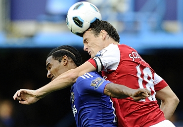 Chelsea's Florent Malouda challenges Arsenal's Sebastien Squilacci during their English Premier League match
