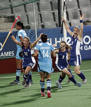 Scotland players celebrate after scoring the first goal against India during their hockey group match at the Commonwealth Games