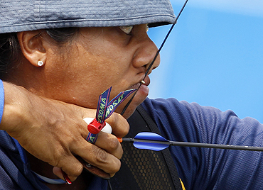 Sri Lanka's Dilhara Lahiru Prasadini Salgado in action during the qualification heats for the women's 70m archery event