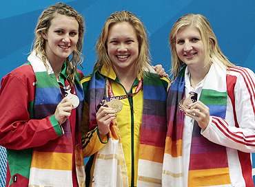 Gold medallist Kylie Palmer (centre) poses with silver medallist Jazmin Carlin (left) and bronze medallist Rebecca Adlington after winning the women's 200m freestyle swimming final