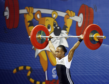 Augustina Nkem Nwaokolo of Nigeria competes in the women's 48kg weightlifting competition