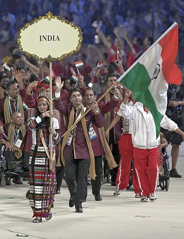 Abhinav Bindra walks with the Indian contingent at Nehru Stadium