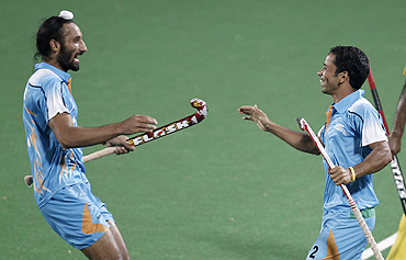 India's Bharat Chikkara (right) celebrates with teammate Sardar Singh after scoring the winner against Malaysia