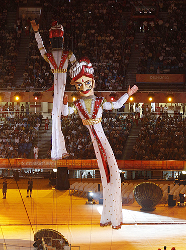 Giant puppets displayed inside the Jawaharlal Nehru stadium during the Commonwealth Games opening ceremony