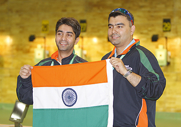 Abhinav Bindra and Gagan Narang with the tricolour after their gold medal-winning feat