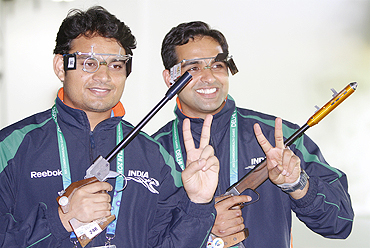 India's Deepak Sharma and Omkar Singh are all smiles after clinching silver in 50m pistol event