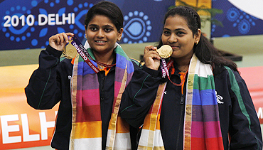 Anisa Sayyed of India (right) and compatriot Rahi Sarnobat pose with their gold medals after winning the women's 25m pairs pistol shooting competition
