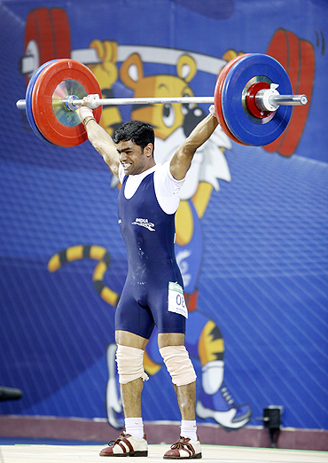 Rustam Sarang of India competes in the men's 62kg weightlifting competition