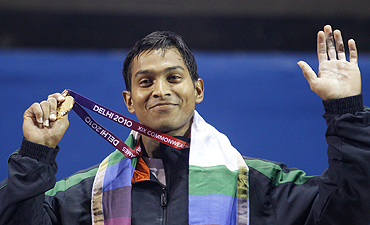 K Ravi Kumar shows off his gold medal