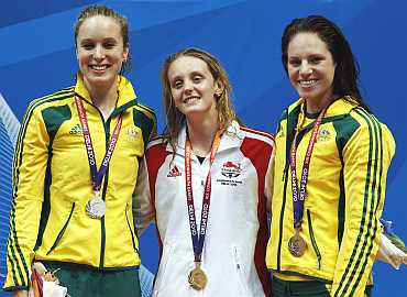 Fran Halsall of England along with Australia's silver medallist Marieke Guehrer (L) and bronze medallist Emily Seebohm (R)