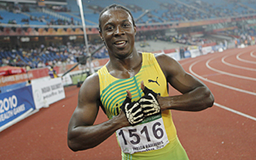 Jamaica's Lerone Ephraime Clarke celebrates after winning the men's 100 metre final on Thursday