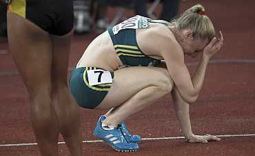 Sally Pearson reacts after being stripped of gold medal