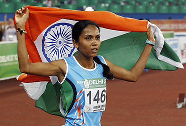 India's Kavita Raut celebrates after claiming the bronze medal in the 10,000 metres event on Friday