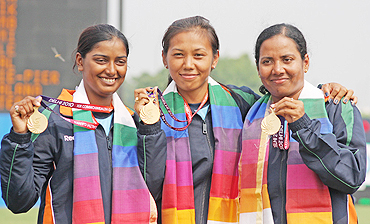 Indian archers Dola Banerjee, Deepika Kumari and Bombayala Devi (women's team recurve), with their gold medals at the  presentation ceremony on Friday