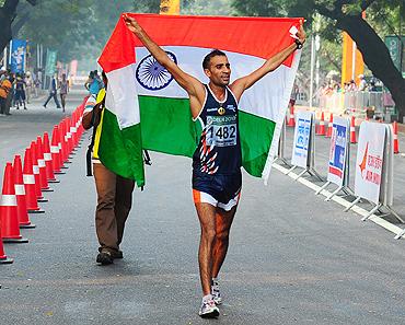 Harminder Singh celebrates after claiming the bronze medal