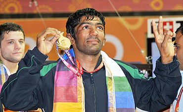Yogeshwar Dutt celebrates after winning the gold medal in (men's) 60Kg freestyle wrestling on Saturday