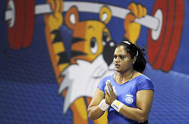 India's Srishti Singh gestures after her successful attempt in the women's 75kg weightlifting competition on Saturday