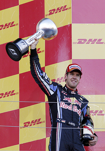 Sebastian Vettel celebrates after winning the Japanese GP