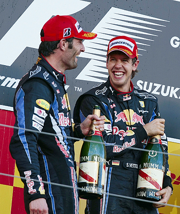 Red Bull's Sebastian Vettel (right) and team-mate Mark Webber celebrate on the podium
