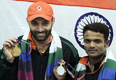 India's gold medallist Harpreet Singh (left) and silver medallist Vijay Kumar after winning the men's single 25m centrefire pistol shooting final on Sunday