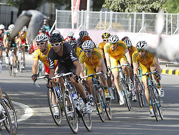 Cyclists compete in the men's road race cycling event on Sunday