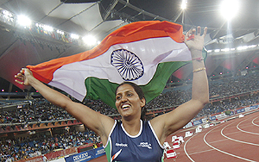 India's Krishna Poonia celebrates her gold medal feat in the women's discus event on Monday