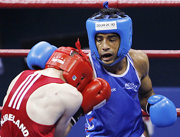 India's Dilbag Singh (blue) lands a punch on Northern Ireland's Patrick Gallagher during their semi-final men's 69kg boxing match on Monday