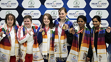 Scotland's gold medallists Jen Mclntosh (3rd from right) and Kay Copland (3rd from left) with England's silver medallists Michelle Smith and Sharon Lee and India's bronze medallists Meena Kumari and Tejaswini Sawant