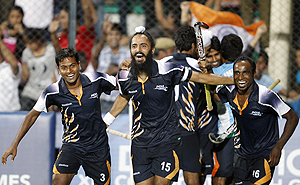 The Indian hockey team celebrates after beating England