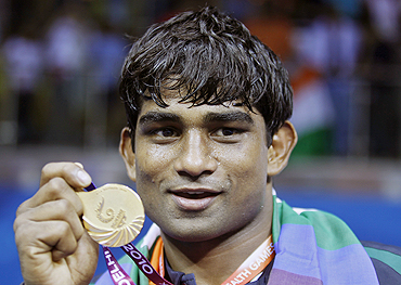 India's Paramjeet Samota poses with his gold medal on Wednesday
