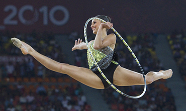Australia's Naazmi Johnson competes with the hoop during her gold medal performance in the rhythmic gymnastics event on Wednesday