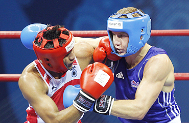India's Manoj Kumar (left) lands a punch on England's Bradley Saunders during their final on Wednesday