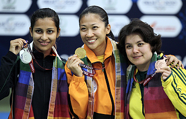 Malaysia's Ng Pei Chin Bibiana (centre) poses with India's silver medallist Heena Sidhu (left) and Australia's bronze medallist Dina Aspandiyarova after winning the women's singles 10m air pistol shooting finals on Wednesday