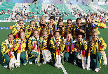 Australia's players pose after clinching the gold medal after the women's field hockey final on Wednesday