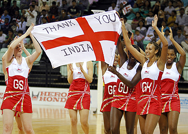 England players celebrate after defeating Jamaica in their women's netball bronze medal match on Thursday
