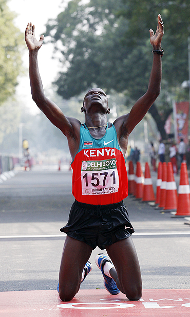 John Kelai thanks the Almighty after winning the marathon on Thursday