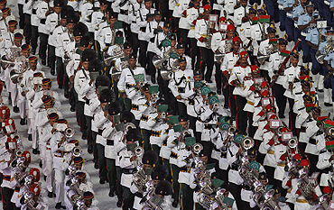 Indian soldiers play musical instruments during the Commonwealth Games closing ceremony