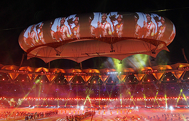 Performers participate under the aerostat during the Commonwealth Games closing ceremony