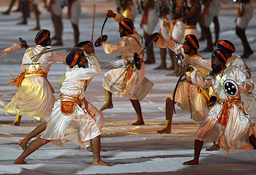 Indian Sikh artists perform during the Commonwealth Games closing ceremony on Thursday
