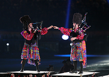 Scottish performers play bagpipes at the closing ceremony