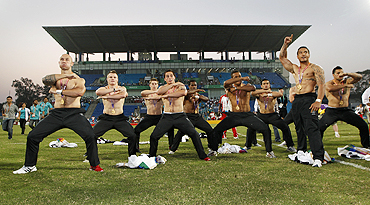 New Zealand players perform the Haka after receiving their gold medals for winning the rugby sevens final