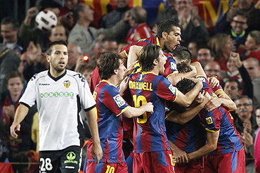 Barcelona players celebrate after Puyol's goal