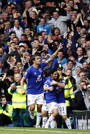 Everton's Tim Cahill celebrates after scoring against Liverpool