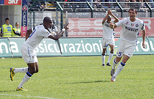 Inter Milan's Samuel Eto'o (left) celebrates with teammate Dejan Stankovic after scoring against Cagliari on Sunday